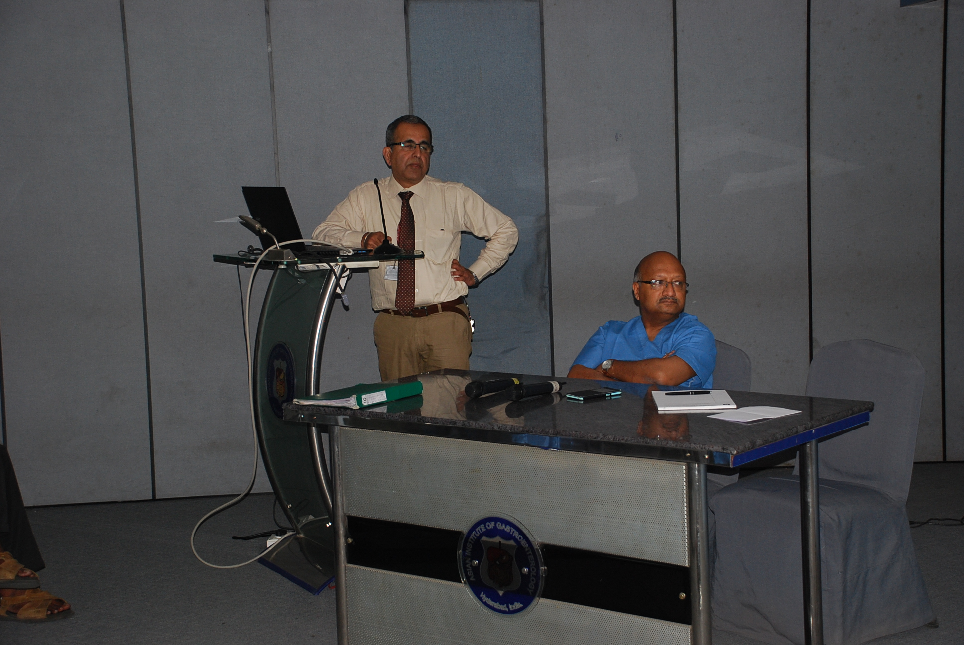 Doctors giving presentation to patients