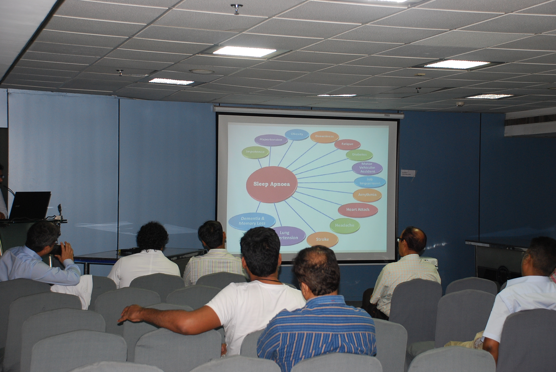 Doctors giving presentation to patients (3)