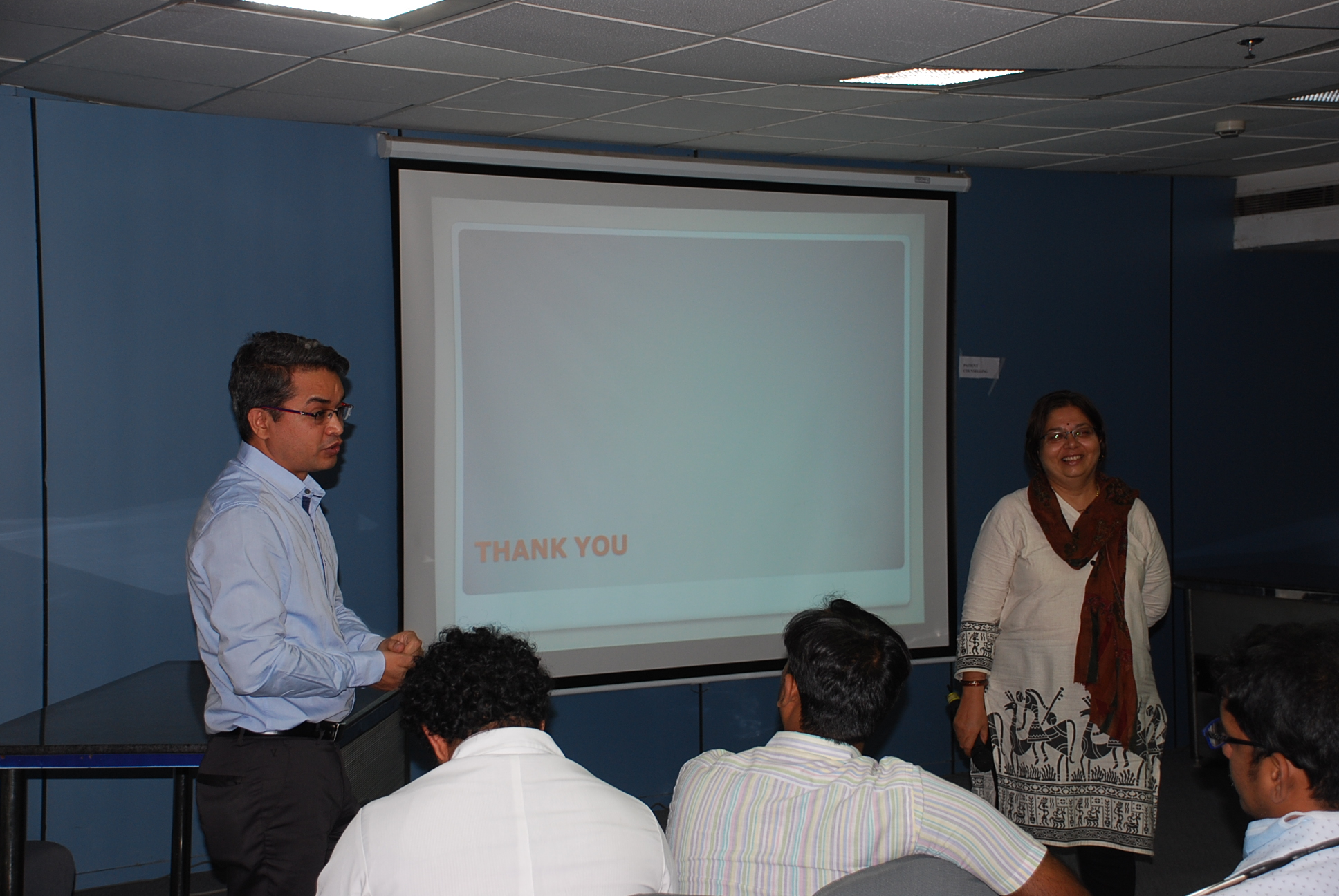 Doctors giving presentation to patients (6)